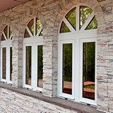 Остекление арочными оконными конструкциями